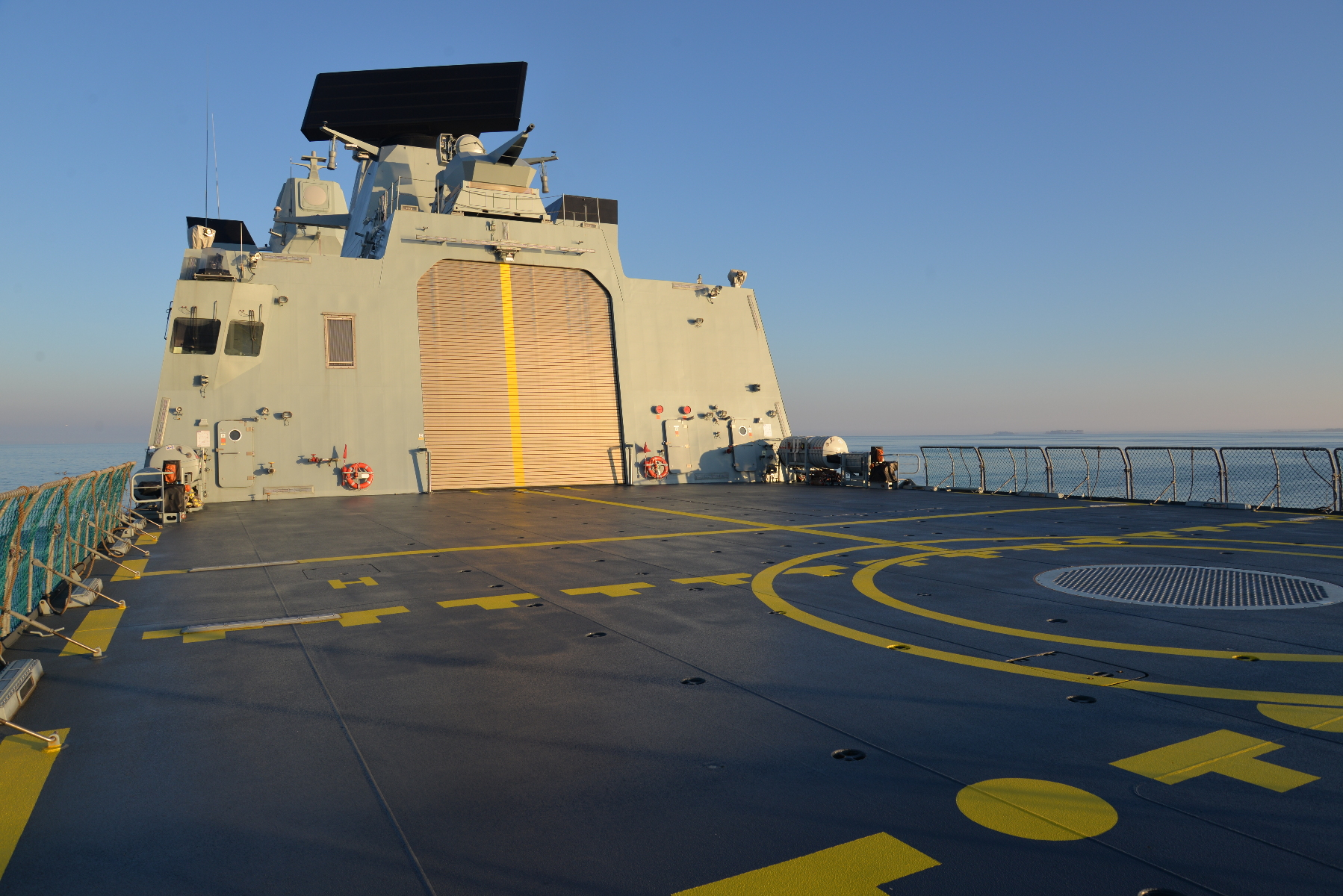 The large flight deck is limited to aircraft of 20,000 pounds -- big enough for EH-101 and NH-90 helicopters. The flight control station is at left.