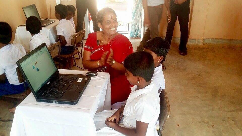Care for Education - Children with Laptop