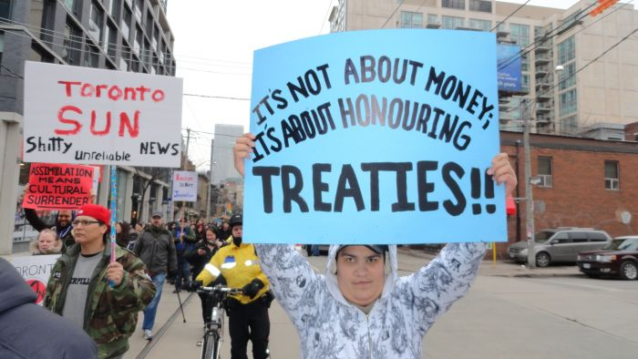 Protesters rally outside of the Sun News studio in Toronto on January 19, 2013, voicing concern over what they call the station's racist overage of Idle No More. PHOTO: Peter Biesterfeld.