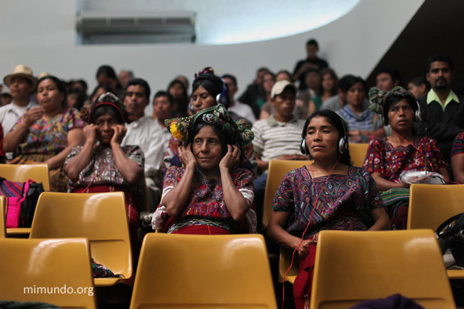 Ixil Maya women listen to the Spanish-Ixil translated courtroom proceedings during the twentieth day of the trial. Photo by James Rodriguez / Mimundo.org. Used with permission.