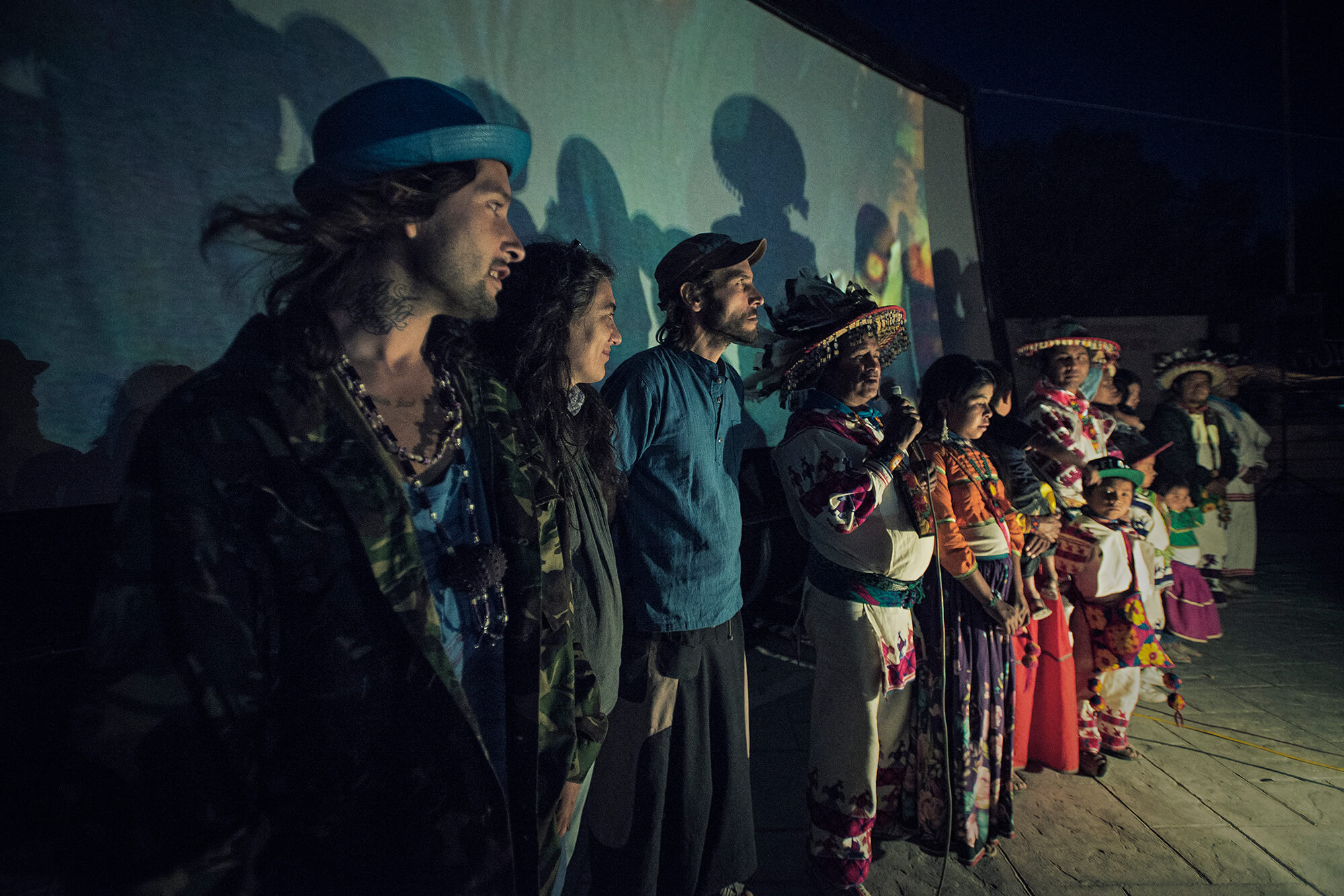 "José Luis ""Katira"" Ramírez introduces the film in Estación Catorce, in the sacred territory of Wirikuta, flanked by the film crew and his family. (Credit: José Andrés Solórzano)"