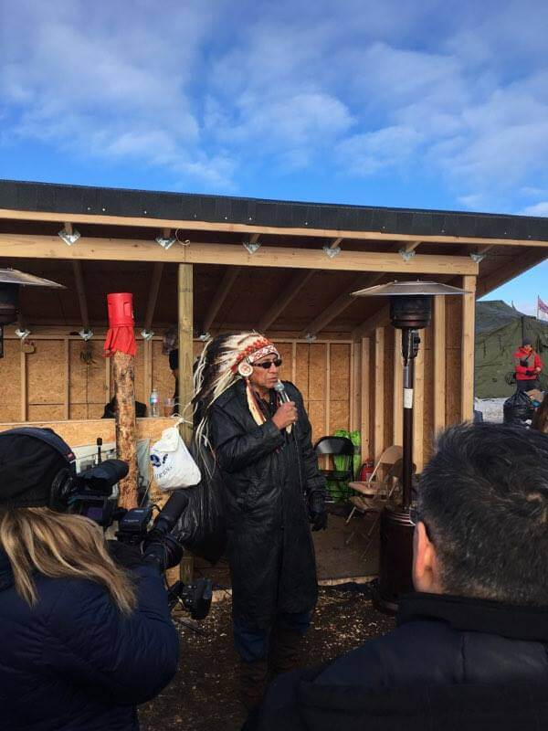 Chief Arvol Looking Horse announcing the U.S Army Corps  decision. Photo: Nelson Denman