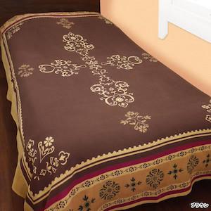 アジアンテイストの布をベッドに