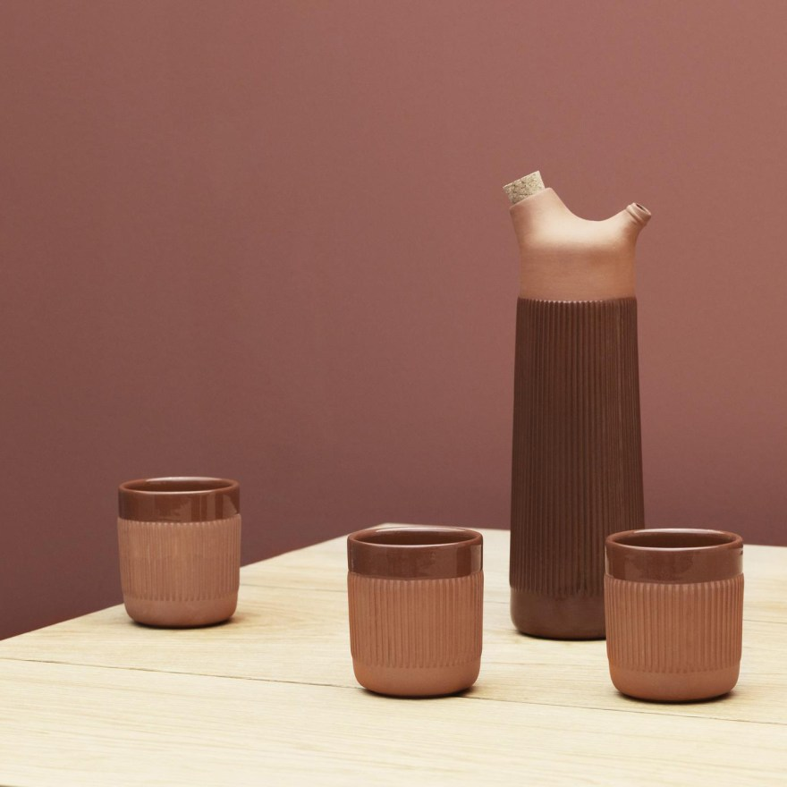The Rustic and Warm Character of the Junto Carafe and Mug Terracotta Design by Simon Legald  for Normann Copenhagen