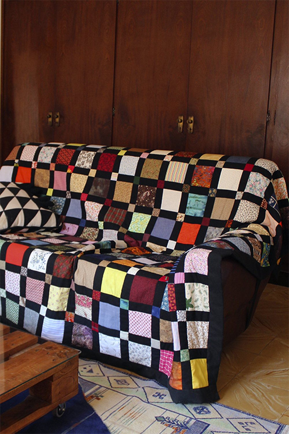 Patch quilt on sofa at Bussoga