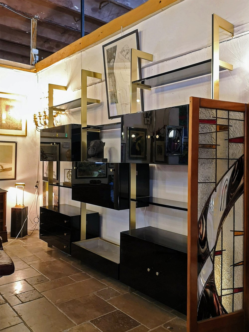 Seventies black lacquered brass shelving system