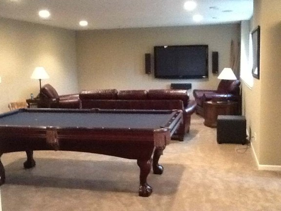 Basement Makeover: Before - A blank wall with a TV is missing something...
