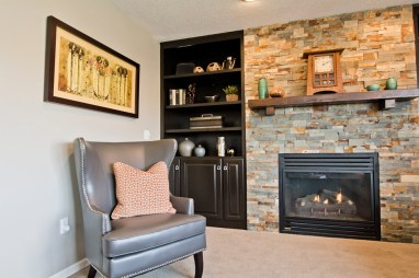 Stone wall enhances the fireplace