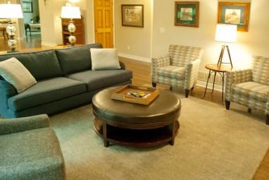 After: Wood floors & area rug keep the homey feeling