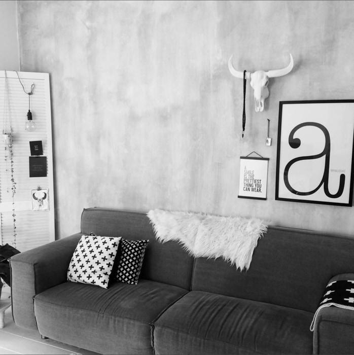 betonlook muur woonkamer harmoni_eus
