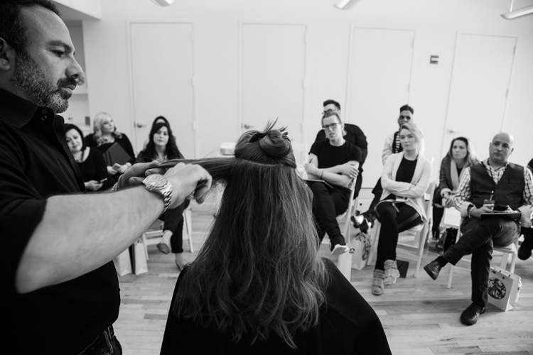 Stylist Michael Angelo teaching a Bjork-inspired hairstyling workshop in NYC for Oribe