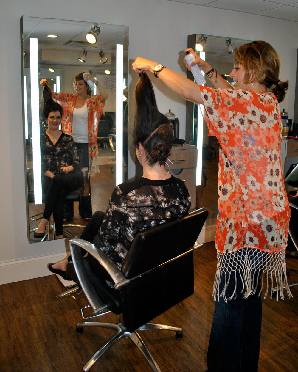 stylists practice updos during Shu Uemura education event