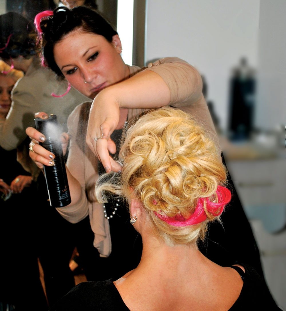 Stylists Christine and Michelle practice updos during Shu Uemura education event
