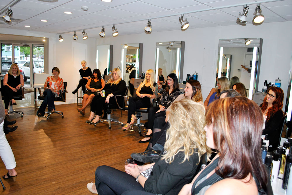 group shot of stylists during education of Shu Uemura products and styles at INTERLOCKS