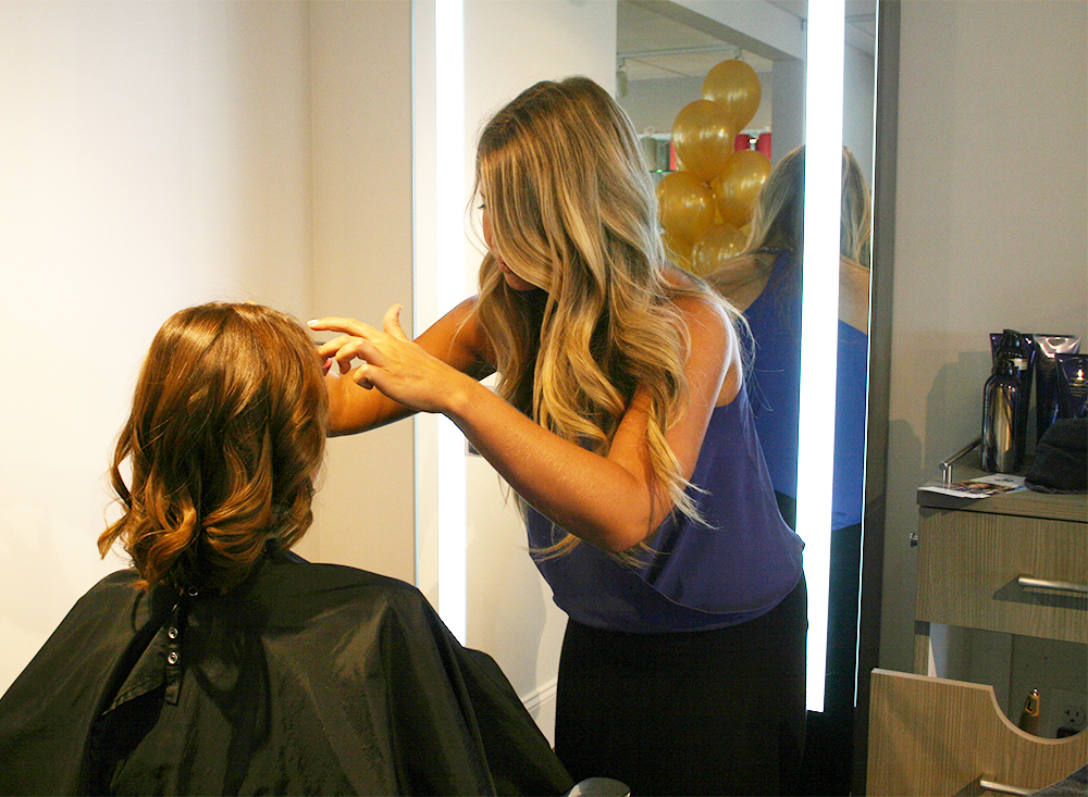 Holly styling hair during our Effortless Summer event
