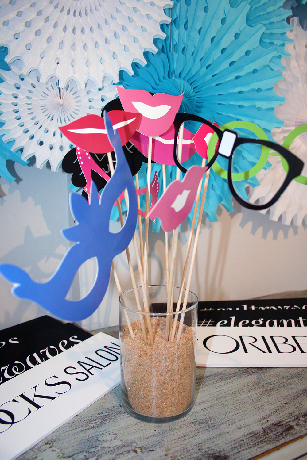 Photo booth props at INTERLOCKS Effortless Summer hair and makeup event
