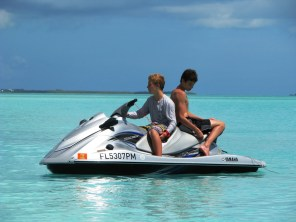 Boys on a jet ski at Treasure Cay, Abacos, Bahamas