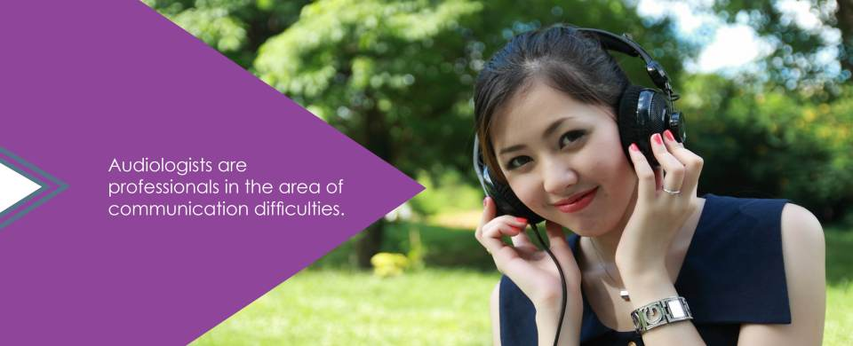 "A young woman listens to headphones and smiles. Text says, ""Audiologists are professionals in the area of communication difficulties."""