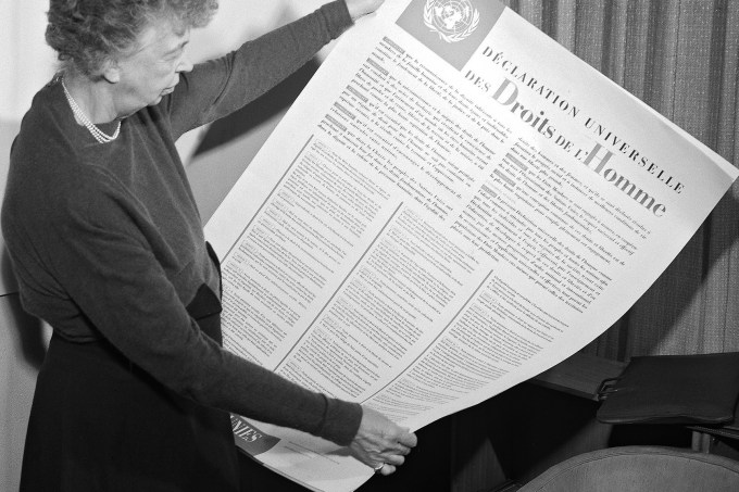 Eleanor Roosevelt, chair of United Nations Human Rights Commission, holds a Universal Declaration of Human Rights poster in November 1949 at the United Nations in New York.