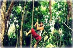 Swinging on jungle vines on Villingili Island in the Maldives