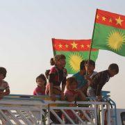 Ezidi kids with Sengal flags