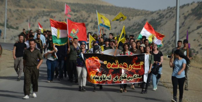 Image result for marching from Derrick, Rojava to Bașur