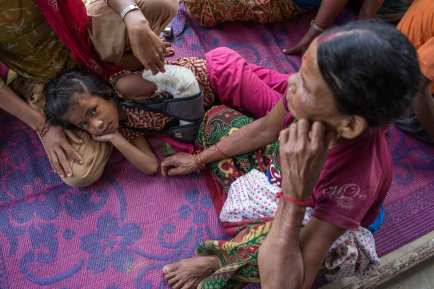 DHUWAKOT-NEPAL-July-17-2015-Residents-wait-for-medical-checks-at-the-entrance-of-a-house-where-a-team-of-physiotherapists-from-International-Medical-Corps_WEB