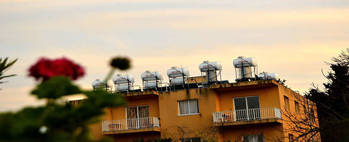 PAPHOS, CYPRUS - March 19: An apartment building has seven solar thermal apparatus' on its roof, which provide warm water to run appliances such as bathing water throughout the entire unit. Ninety-five percent of the homes in Cyprus have solar thermal systems on their rooftops.