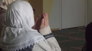 PHOTO/Madeleine Winer A Muslim woman prays during a Friday service at the Turath Islamic Center in Tallinn, Estonia.