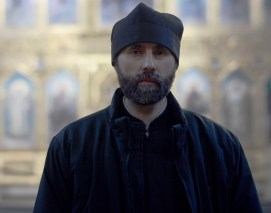 PHOTO/ Jacob Byk A Russian Orthodox deacon stands watch and greets visitors at Alexander Nevsky Cathedral in Tallinn. The deacon spoke English while many of the Russian Orthodox laypeople working in the church did not.