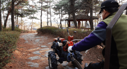 Choi riding his Korean-styled tractor.