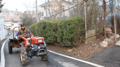 Choi riding his Korean-style tractor.
