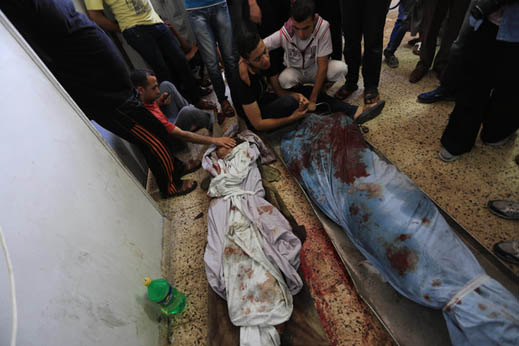 Palestinian relatives mourn over the body of Mahmud al-Sewati during his funeral