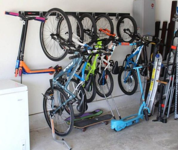 Vertical bike storage on the wall with large amount of bike