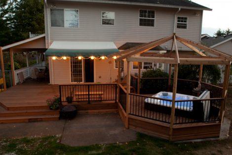 Over deck hot tub enclosure