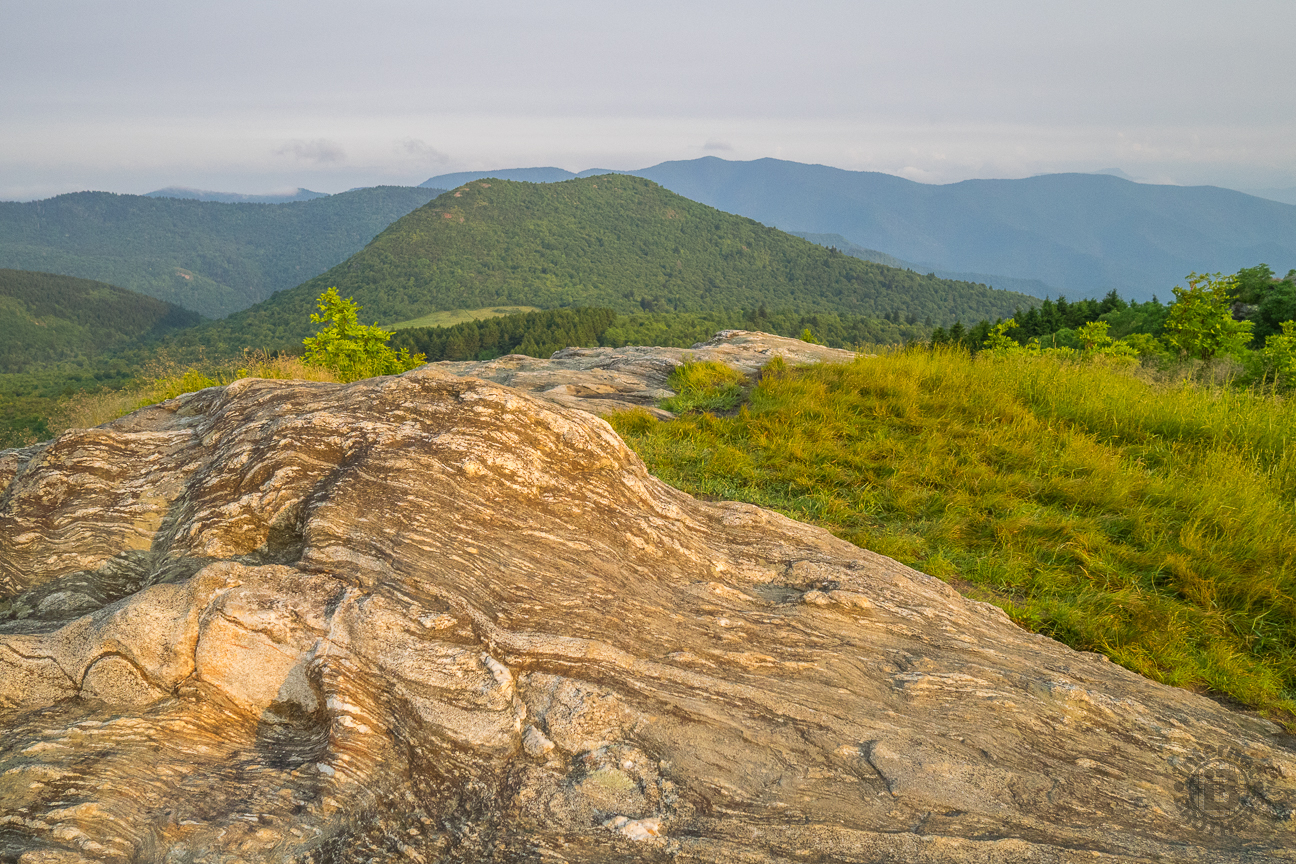 The plateaus along the Art Loeb Trail are covered with this exposed wavy granite. That is the double-humped Sam Knob in the background, the later destination for this hike.