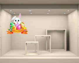 Simpatico coniglietto tra uova-adesivo per vetrine