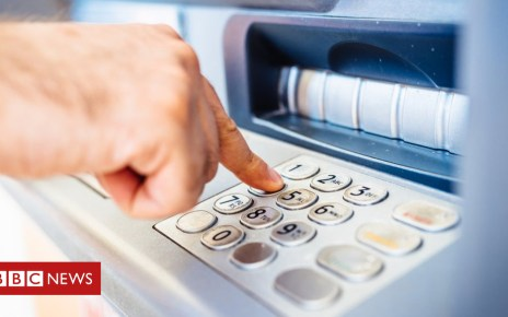 98972062 atm getty - Debate over cash machines hots up