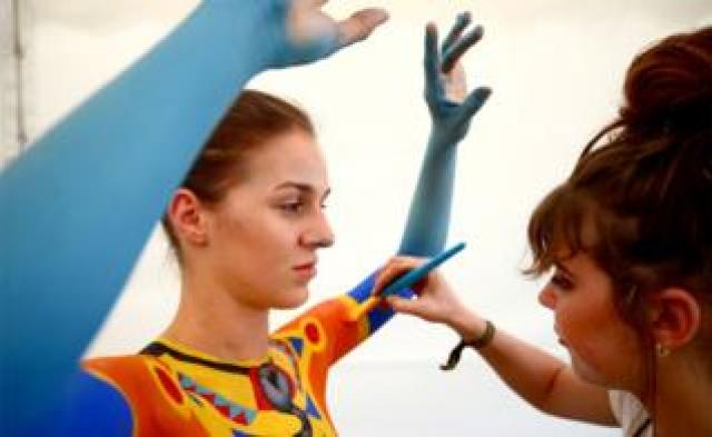 Carla Gouws from South Africa paints model Corina