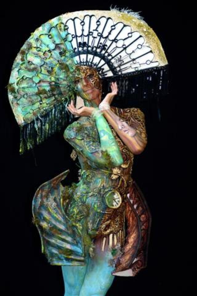 A model, painted by bodypainting artists Yvonne Zonnenberg-Hughes and Astric Hughes from South Africa, poses for a picture