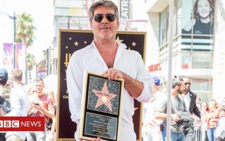103140371 simon cowell - Simon Cowell gets star on Hollywood Walk of Fame