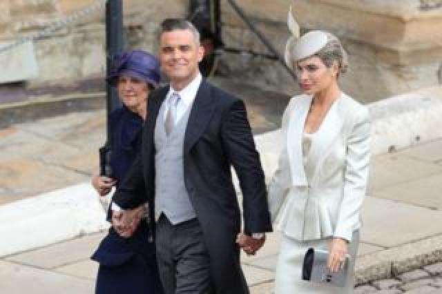 Robbie Williams and Ayda Field (right) arrive for the wedding of Princess Eugenie to Jack Brooksbank at St George's Chapel in Windsor Castle
