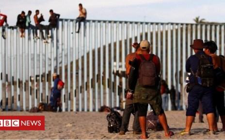 104331496 p06rr1lc - Caravan migrants reach United States border