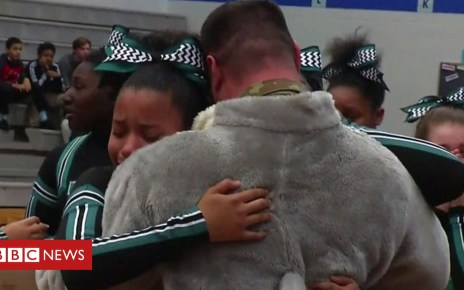 104869284 p06w0c9v - US Air Force dad surprises daughters as dolphin mascot