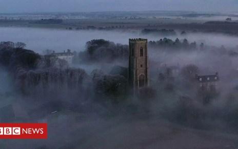 105487073 p070099d - Drone captures Southrepps 'radiation fog' daybreak