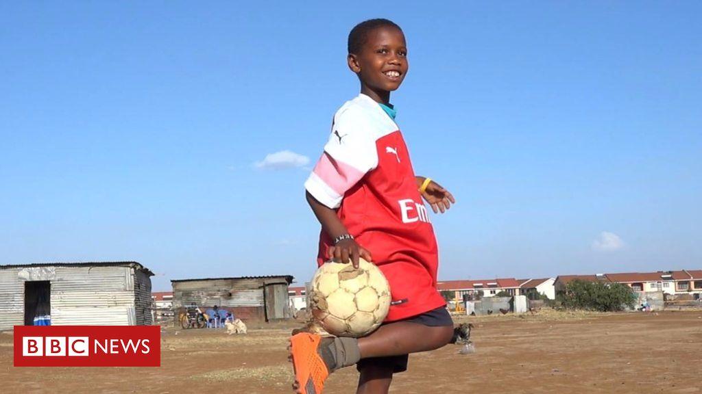 106039402 p073nnzy - Why Arsenal's Mesut Ozil sent a Kenyan boy football boots
