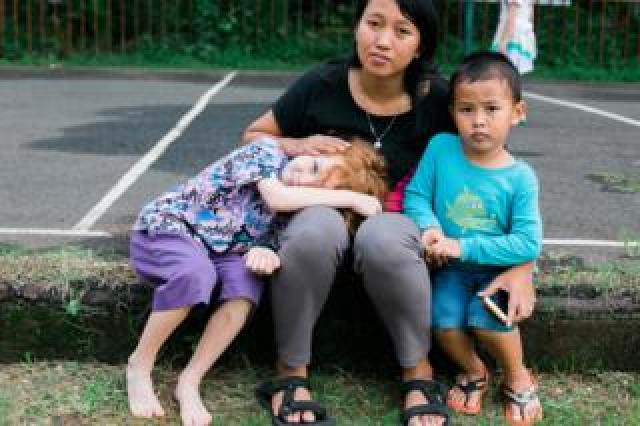 Fitri with her son and Rebecca's youngest son