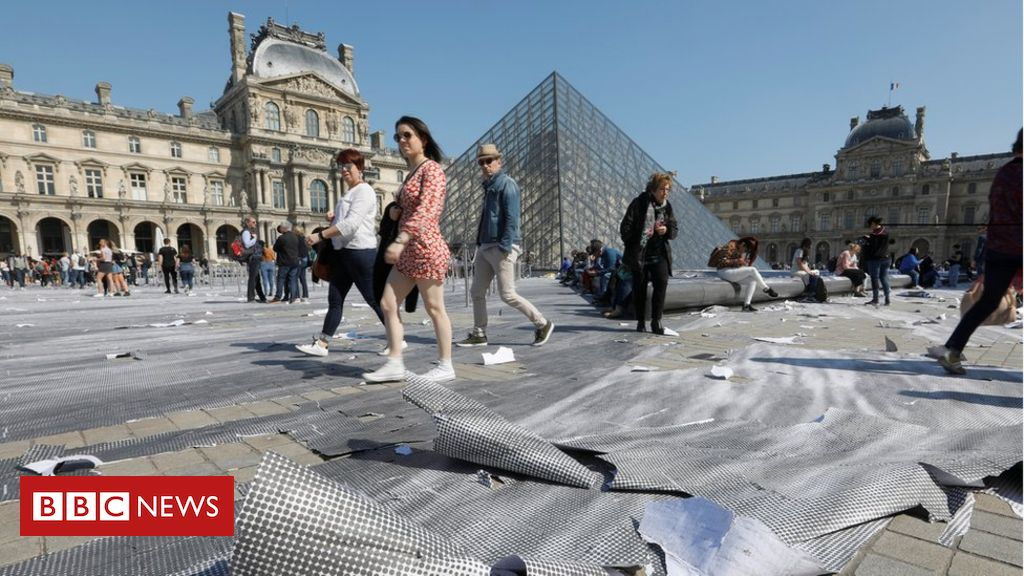 106257834 louvrereu - Louvre's giant paper artwork shredded in hours by visitors' footsteps
