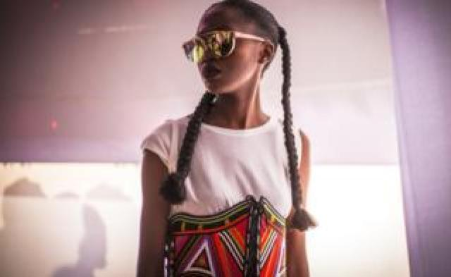 A model wearing a colourful and handcrafted accessory by fashion label Moyo By Bibi during Dakar Fashion Week in Dakar, Senegal