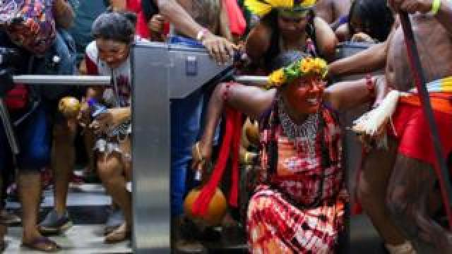 Brazilian indigenous break into the Ministry of Health office during a protest against budget cuts